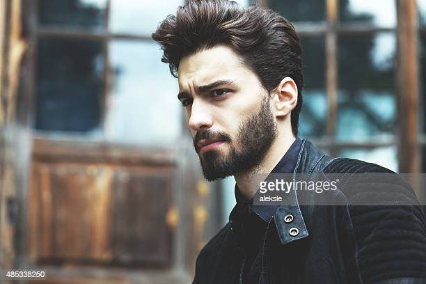Fashion portrait of a handsome bearded man