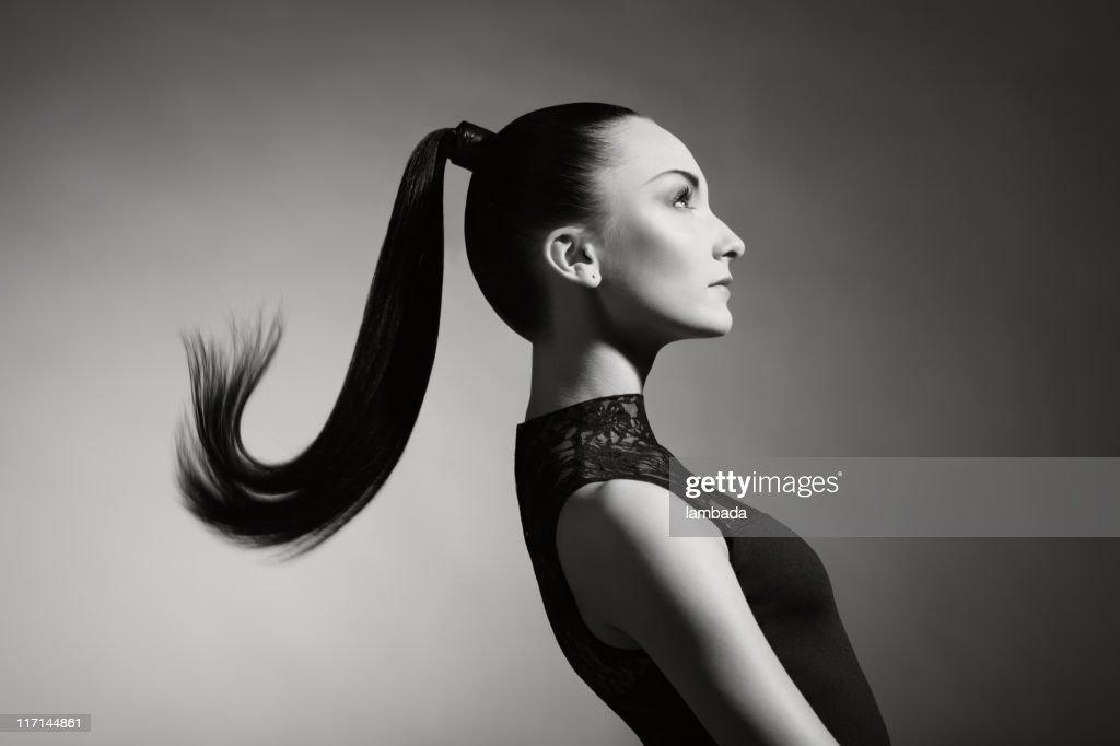 Fashion portrait of beautiful woman with ponytail : Stock Photo