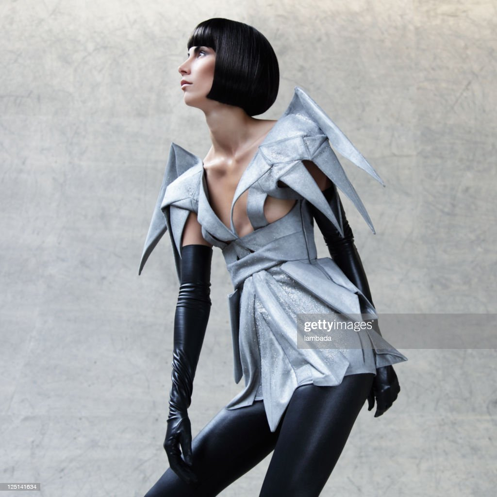 fashion portrait of woman in futuristic clothes stock