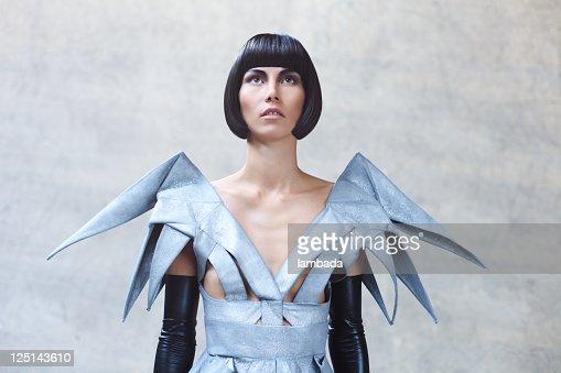 Fashion portrait of woman in futuristic clothes