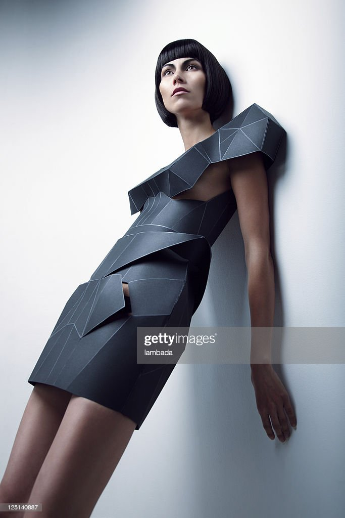 fashion portrait of woman in futuristic dress stock photo