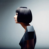 Fashion portrait of woman in futuristic dress