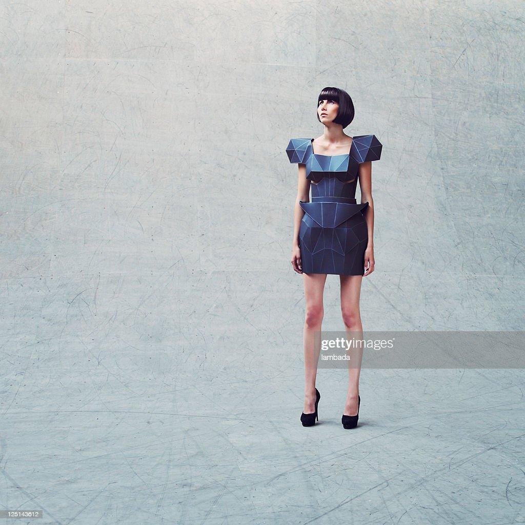 fashion portrait of woman in futuristic dress stock photo