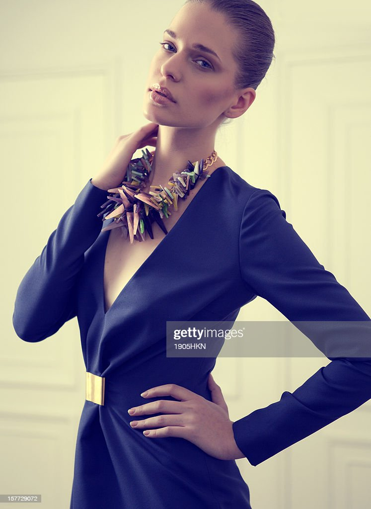 Fashion portrait of young woman : Stock Photo
