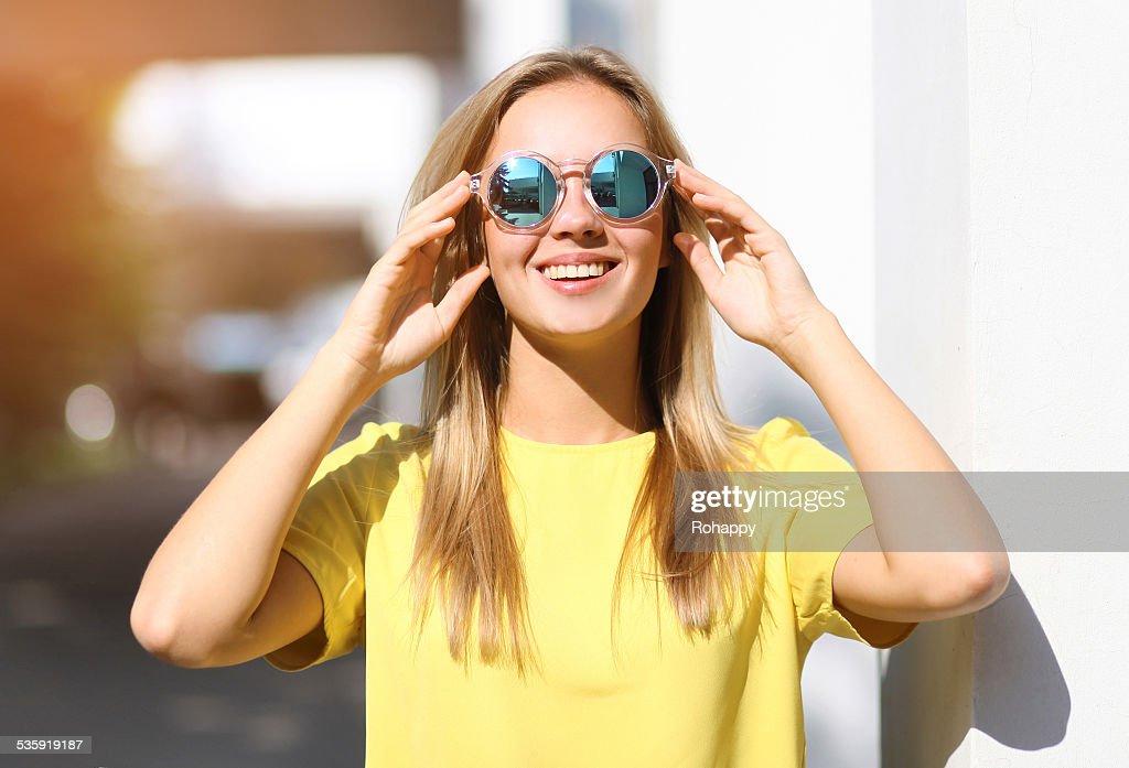 Fashion portrait pretty smiling girl in sunglasses enjoying outd : Stock Photo