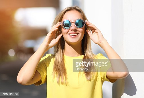 Fashion portrait pretty smiling girl in sunglasses enjoying outd : Stock Photo