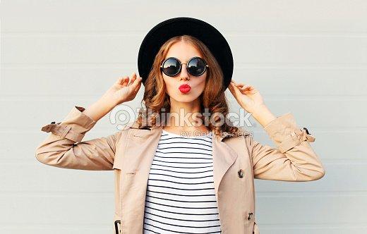 Fashion portrait pretty sweet woman blowing red lips, black hat : Stock Photo