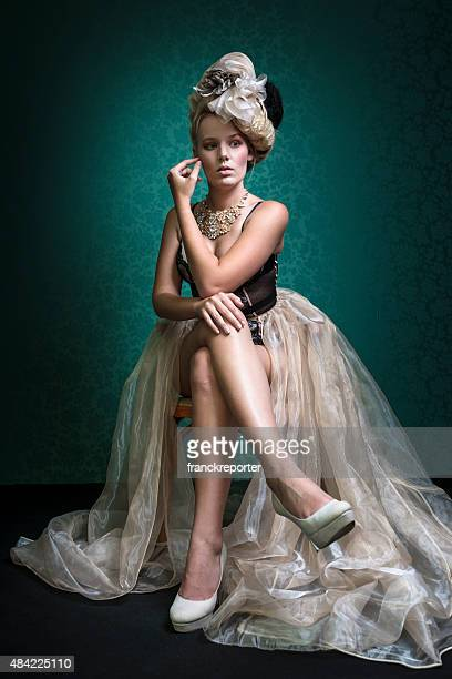 fashion pose of a woman in a marie antoniette look