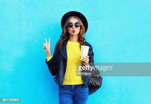 Fashion pretty woman with coffee cup wearing black rock style : Photo