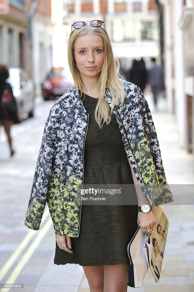 Fashion retailer Jennifer (23) poses wearing Top Shop dress and boots with a H+M jacket, Urban Outfitters sunglasses and a Phillip Lim Clutch at the Holly Fulton catwalk show during London Fashion Week S/S 2013 on September 15, 2012 in London, England.