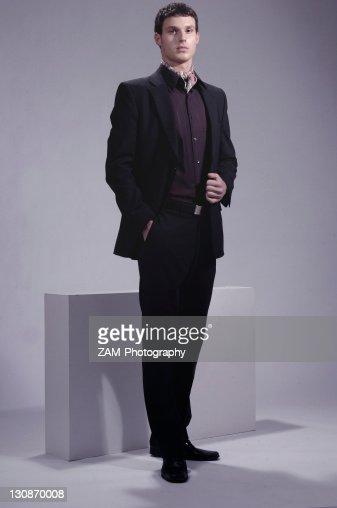Fashion shot of a young man wearing a suit