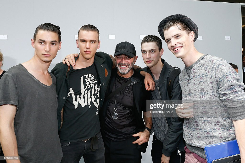 Fashion show designer Etienne Russo (C ) with models backstage after Dior Homme Menswear Spring/Summer 2014 Show as part of the Paris Fashion Week on June 29, 2013 in Paris, France.