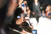Using smart phone to film fashion show
