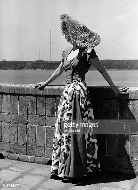 sleeveless jacket buttoned twice and a long wrap skirt in linen 1951 Photographer Charlotte Rohrbach Published by 'Radio Revue' 25/1951 Vintage...