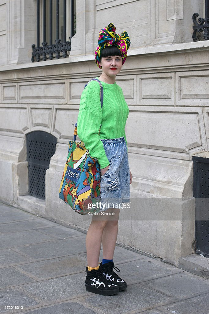 Fashion Student Abbie Stirrup wears Topshop shoes, Killi Watch vinatge shorts, Cow sweater, a bag from St Lucia and a head scarf from Istanbul on day 3 of Paris Collections: Men on June 28, 2013 in Paris, France.