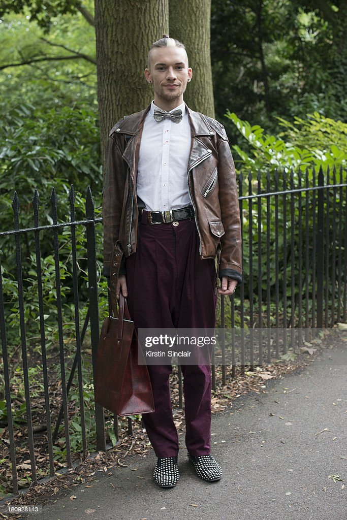 Fashion student Adam Darren McPhater wears Virgin Blak shoes, own design bow tie and trousers, Milano belt, Topman shirt, Jacket and bag from Brick Lane on day 5 of London Fashion Week Spring/Summer 2013, at Somerset House on September 17, 2013 in London, England.