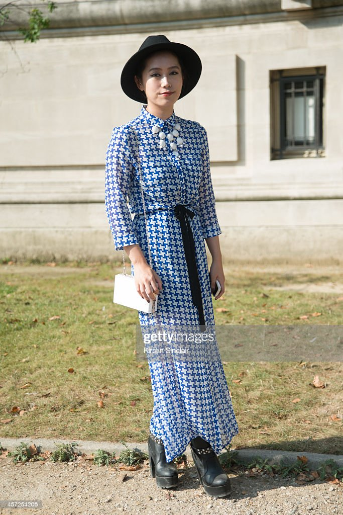 Fashion Student Ami Takahasi is wearing a vintage dress and hat and Zara bag and shoes on day 8 of Paris Collections Women on September 30 2014 in...