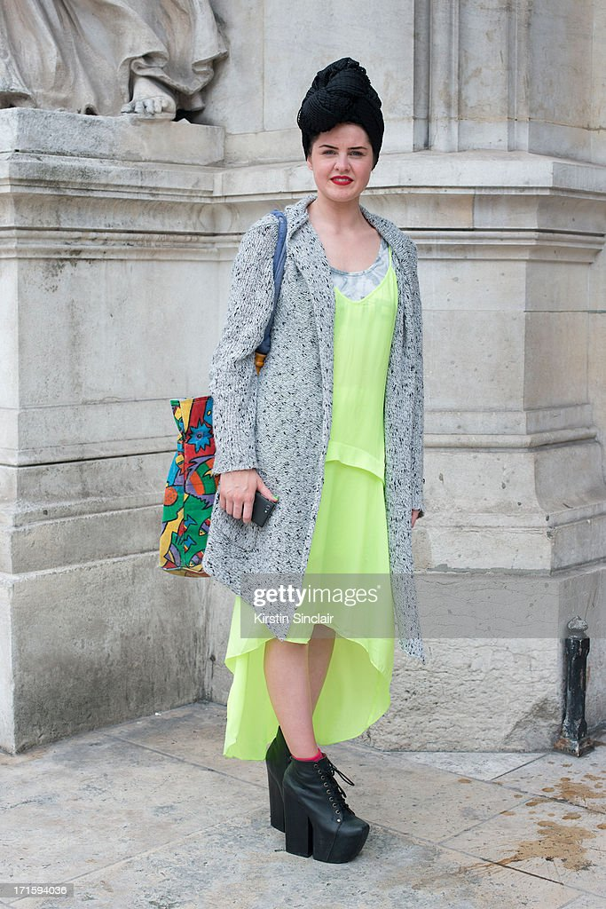 Fashion Student and designer Abbie Stirrup wears Jeffrey Campbell shoes, Top shop Unique dress, vintage Cardigan, Top Shop Vest, a bag from Saint Lucia and a Turban she made herself on day 1 of Paris Collections: Men on June 26, 2013 in Paris, France.