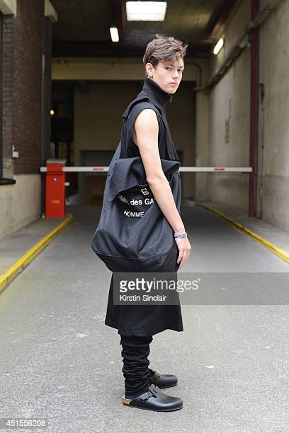 Fashion student and designer for After Homework Peter Kaczmarek wearing Comme Des Garcons skirt and bag Rick Owen vest Margiella scarf After Homework...