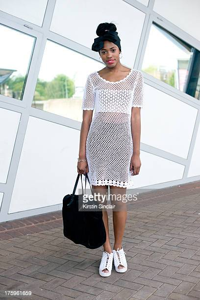 Fashion student and model Bianca Saunders wears Office shoes Monki dress own design headband and a Zara bag on day 4 of Graduate Fashion week on June...