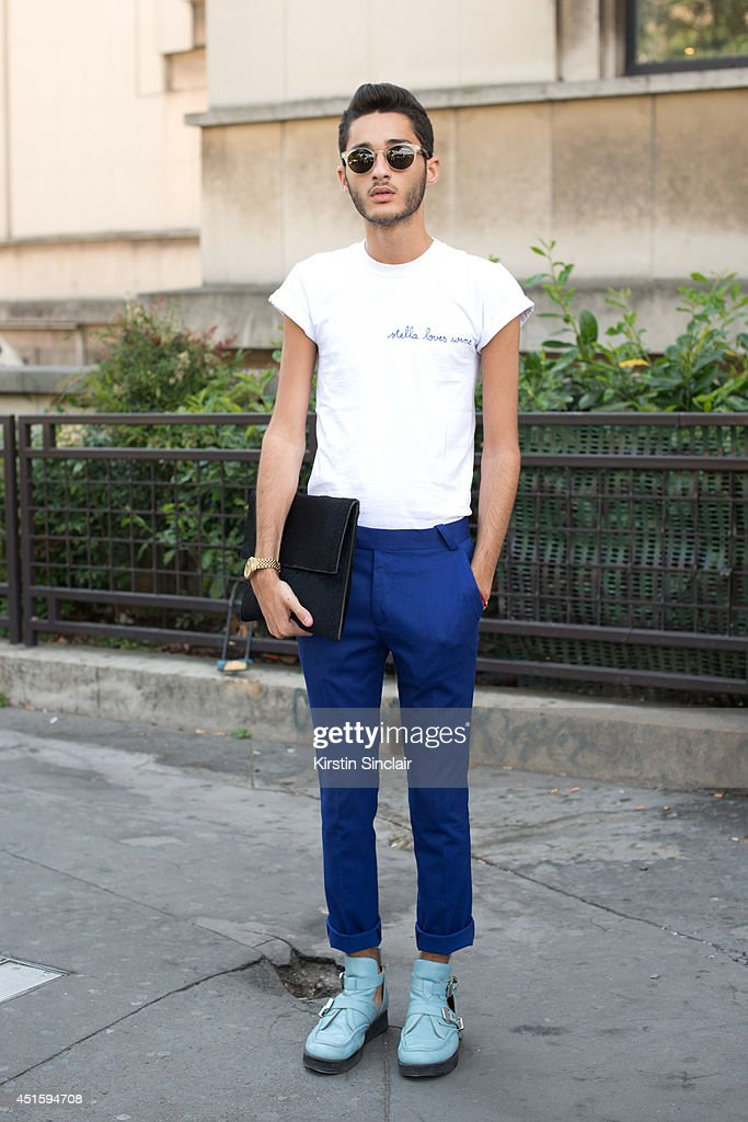 Fashion student Anthony Benaiche wearing a Maison Labiche T shirt, Asos trousers, Solestruck shoes, Paul and Joe sunglasses and Rick Owens bag on day 2 of Paris Collections: Men on June 26, 2014 in Paris, France.