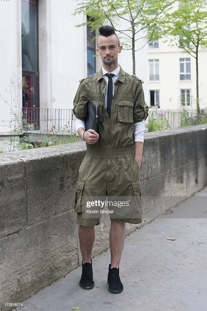 Fashion student Christiaan De Vries wears Clerks shoes, vintage jumpsuit and tie, H and M shirt and clutch bag on day 3 of Paris Collections: Men on June 28, 2013 in Paris, France.