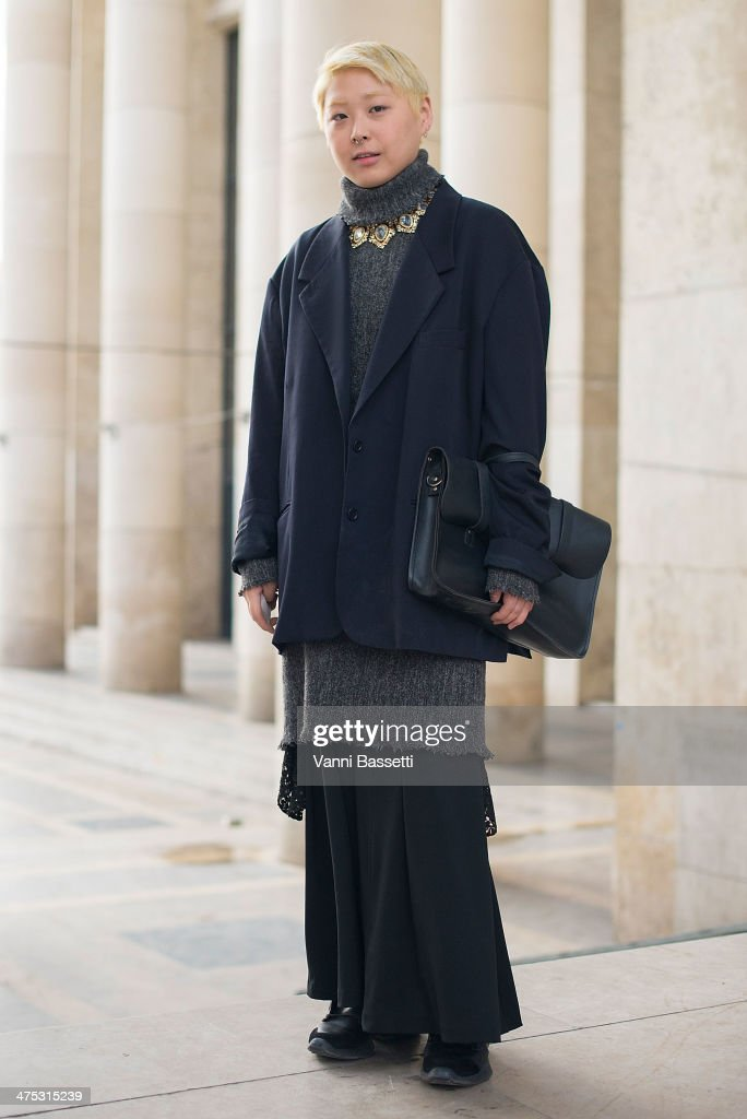 Fashion student Dohan Jung wears Maison Martin Margiela for H&M jacket and Rick Owens for Adidas shoes after Damir Doma show at the Palais de Tokyo on February 26, 2014 in Paris, France.