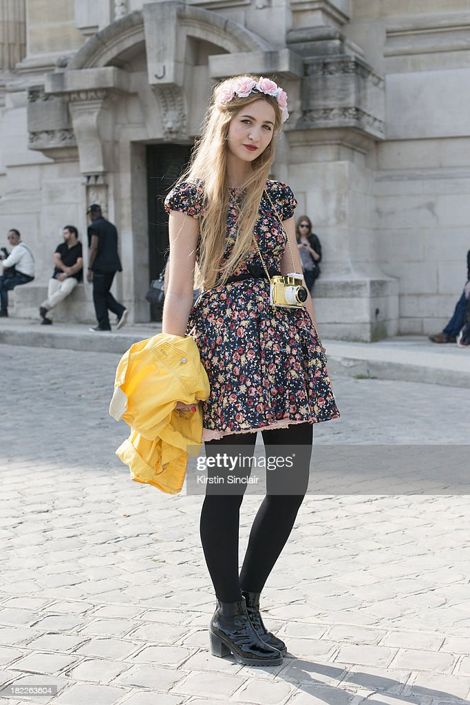 Fashion student Elisa Baudoin wears a Zara dress, Vagabond boots, Asos headpiece and a Dianna F camera on day 5 of Paris Fashion Week Spring/Summer 2014, Paris September 28, 2013 in Paris, France.