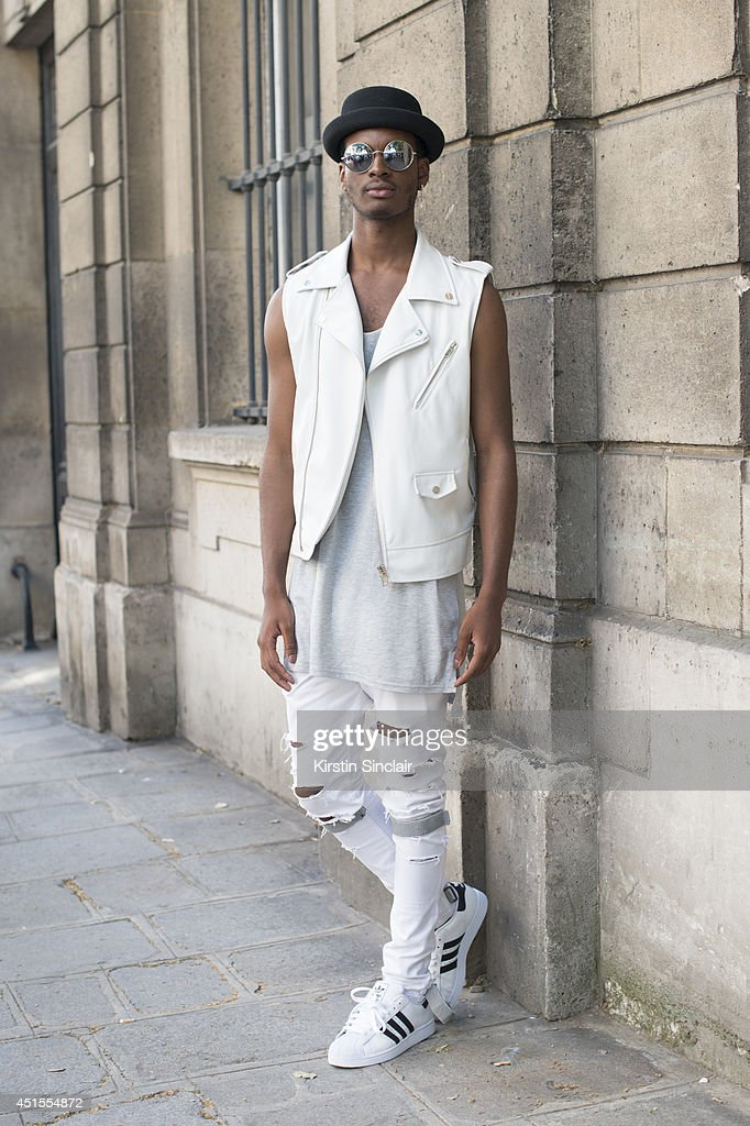 Fashion student Gregory Tevin wearing a Zara jacket, vintage customised jeans, Adidas trainers, vintage sunglasses and a Topshop hat on day 1 of Paris Collections: Men on June 25, 2014 in Paris, France.