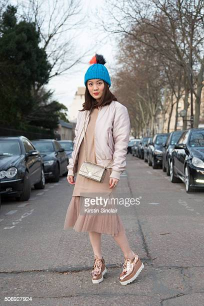 Fashion student Jaime Lo wears a dress from Korea Acne Studio jacket Dior bag Topshop hat and Stella McCartney shoes on day 2 of Paris Haute Couture...