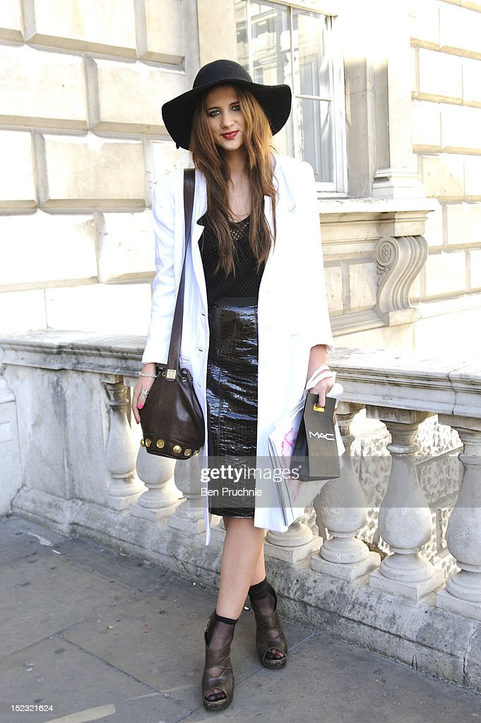 Fashion student Jessica (24) poses wearing Rick Owens shoes, Mark Jacobs skirt, vintage coat and a top from Dalston at Somerset House during London Fashion Week S/S 2013 on September 18, 2012 in London, England.
