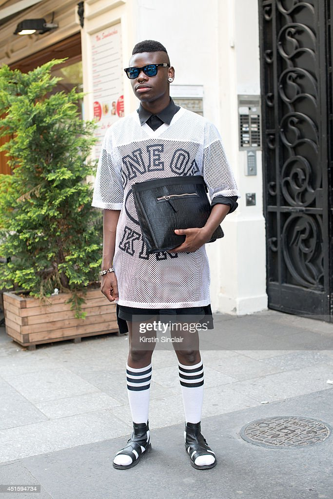 Fashion student Jordan Aiden wearing a Monki top, H and M bag, Antonio Marachi sandals, Asos sunglasses and H and M shirt on day 2 of Paris Collections: Men on June 26, 2014 in Paris, France.