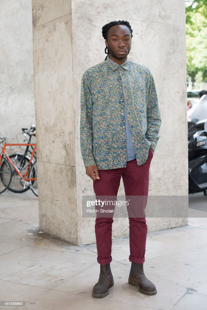 Fashion student Loick Kone wearing a vintage shirt, H and M trousers and Doc Martins boots on day 1 of Paris Collections: Men on June 25, 2014 in Paris, France.
