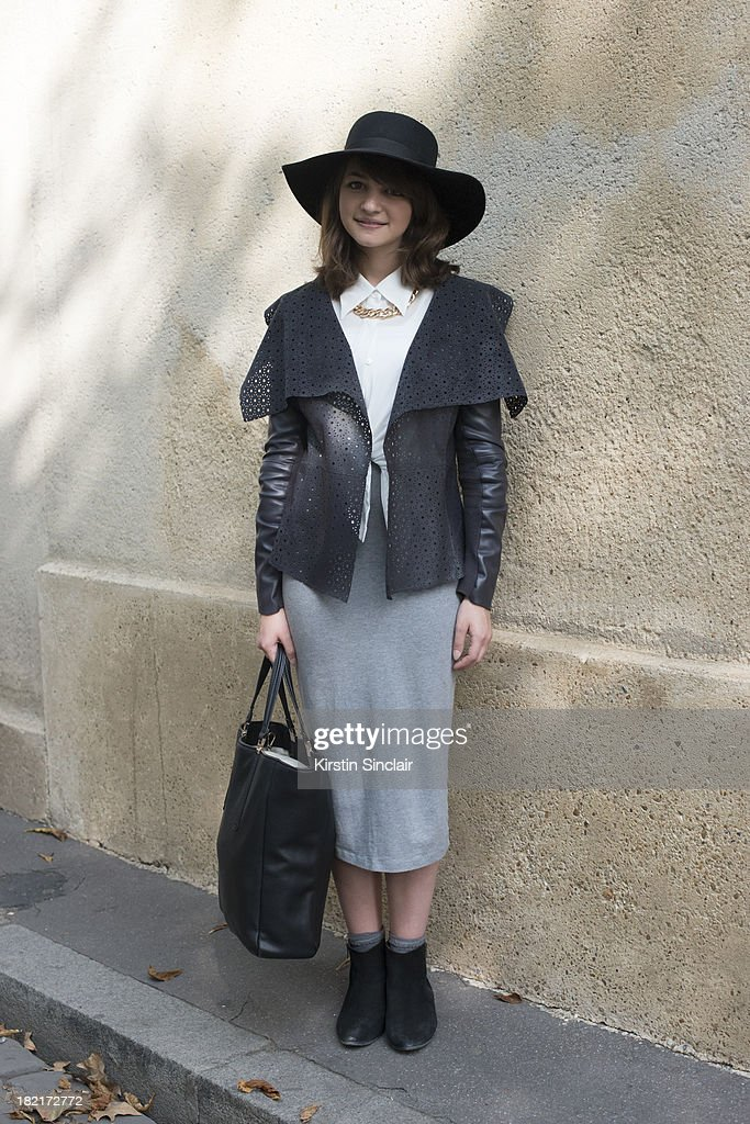 Fashion student Marloes Kamer wears Bettty London boots, Monki skirt, River Island jacket, necklace and hat, vintage shirt and a Zara bag on day 4 of Paris Fashion Week Spring/Summer 2014, Paris September 27, 2013 in Paris, France.