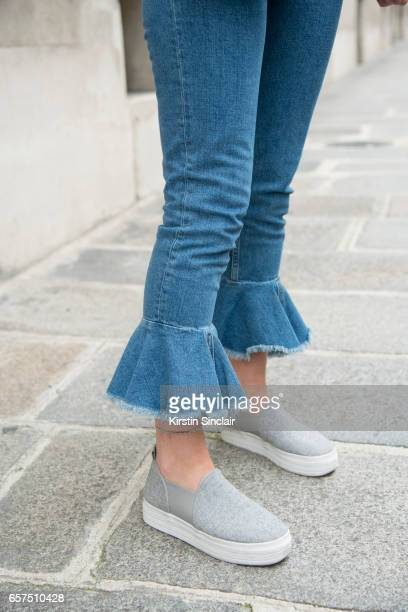 Fashion student Mathilde Martial wears ASOS jeans and HM shoes day 2 of Paris Haute Couture Fashion Week Autumn/Winter 2016 on July 4 2016 in Paris...