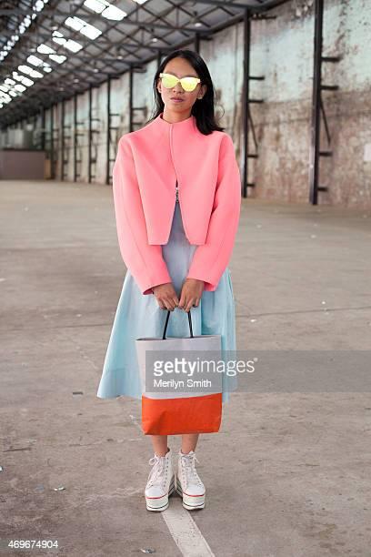 Fashion Student Natasha Chu wears a Kenzo jacket Cos dress and a Siwa bag at MercedesBenz Fashion Week Australia 2015 at Carriageworks on April 13...