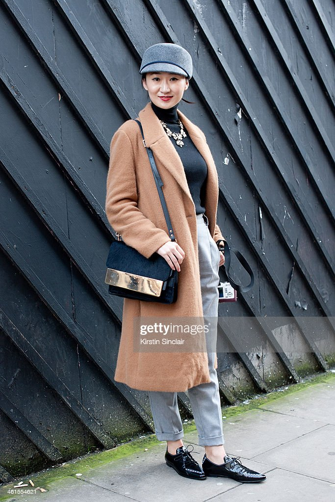 Fashion student Nicole Xu wears a Marc by Marc Jacobs coat American Apparel hat and trousers Cos top J Crew necklace Derek Lam shoes and a Sophie...