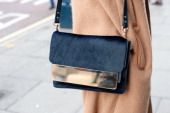 Fashion student Nicole Xu wears a Marc by Marc Jacobs coat and a Sophie Hulme bag day 3 of London Mens Fashion Week Autumn/Winter 2014 on January 08...