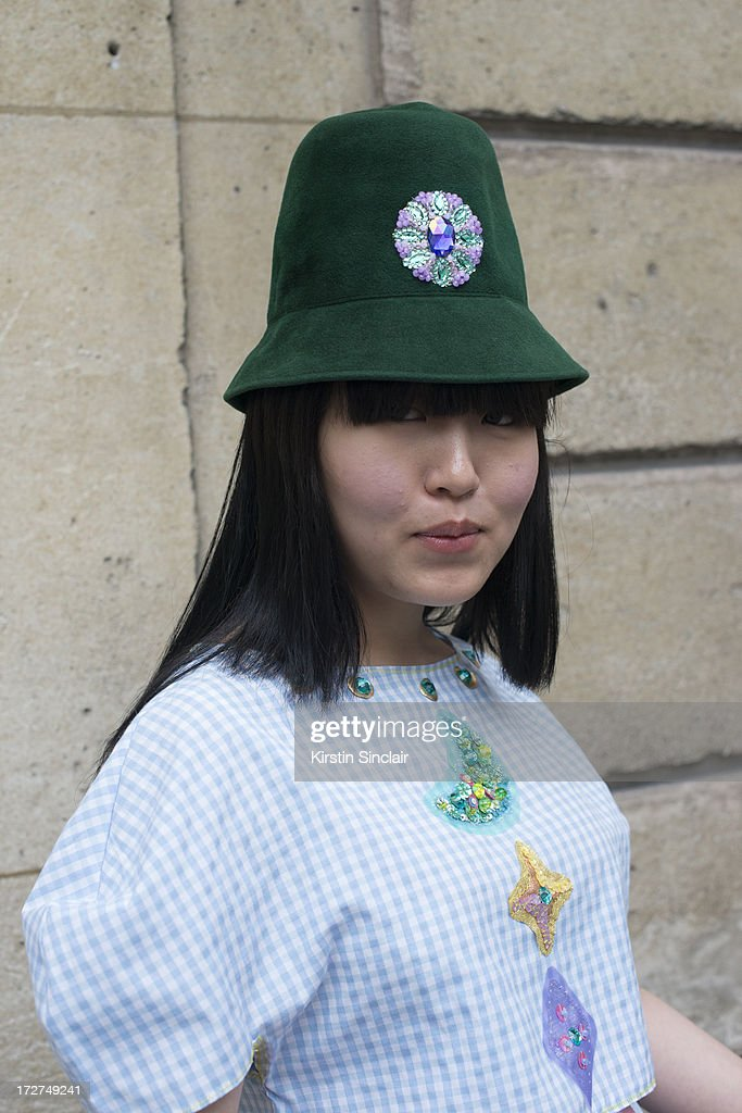 Fashion student Sulgi Lee wears a vintage hat and an own design top on day 3 of Paris Collections: Womens Haute Couture on July 03, 2013 in Paris, France.