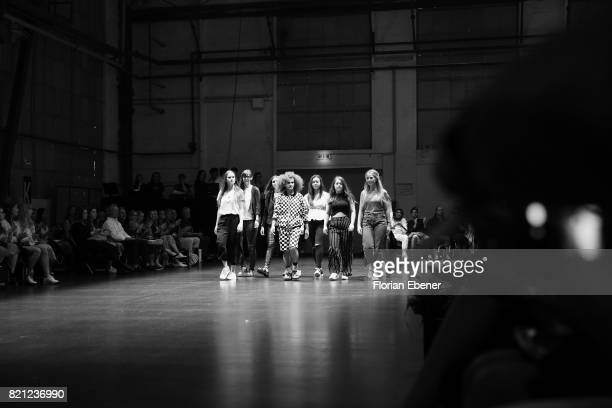 Fashion students walk on the runway at the AMD Exit17_2 show during Platform Fashion July 2017 at Areal Boehler on July 23 2017 in Duesseldorf Germany