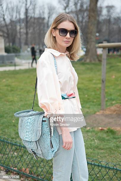 Fashion Stylist Alina Gelzina wears a Chloe shirt Barbara Bui bag and Visionwood sunglasses on day 8 of Paris Collections Women on March 10 2015 in...