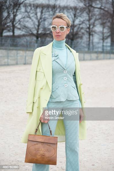 Fashion stylist and blogger Denisa Palsha wears a Chanel coat Prada bag Nanette Lepore suit and Spektra sunglasses on day 8 of Paris Collections...