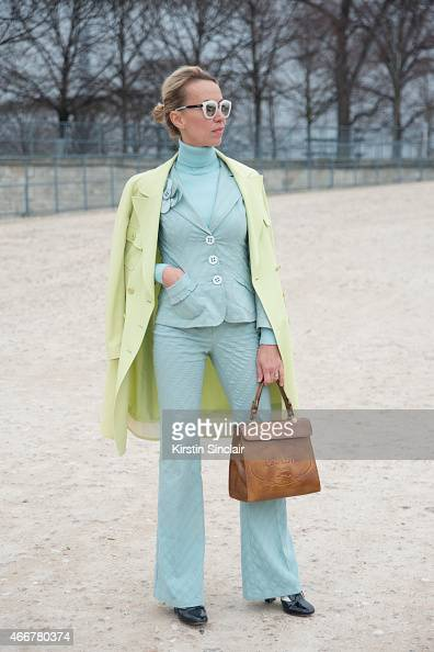 Fashion stylist and blogger Denisa Palsha wears a Chanel coat Prada bag Nanette Lepore suit Valentino shoes and Spektra sunglasses on day 8 of Paris...