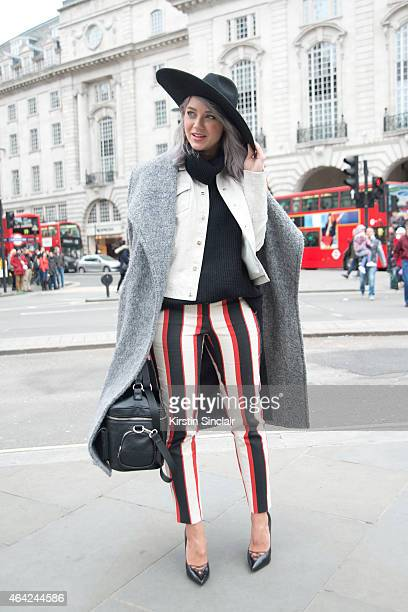 Fashion Stylist and Blogger Madelene Billman wears all River Island with her own design of bag on day 3 of London Collections Women on February 22...