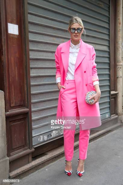 Fashion Stylist and Blogger Sofie Valkiers wears a Designer remix suit Christian Louboutin bag and shoes and Spektre sunglasses on day 5 of Paris...