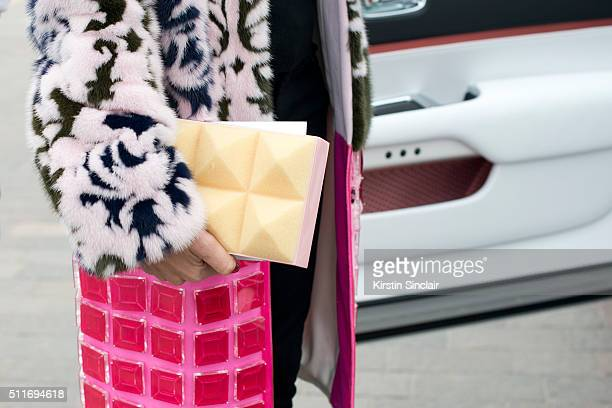 Fashion stylist and consultant Erica Pelosini wears a Mary Katrantzou coat and bag on day 3 during London Fashion Week Autumn/Winter 2016/17 on...