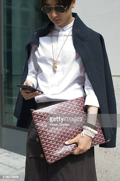 Fashion stylist and journalist Gareth Chau wears Bottega Veneta jacket Valentino skorts Commes Des Garcon shirt Acne glasses and Goyard bag on day 4...