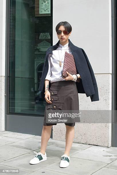 Fashion stylist and journalist Gareth Chau wears Bottega Veneta jacket Valentino skorts and shoes Commes Des Garcon shirt Acne glasses and Goyard bag...