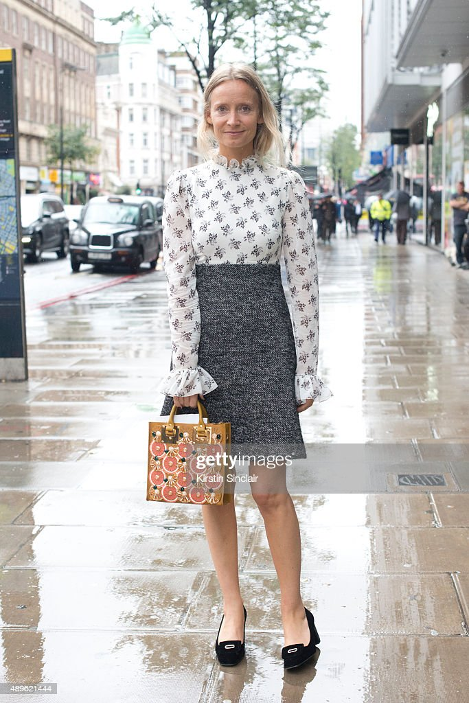 Fashion stylist and presenter Martha Ward wears a Dolce and Gabbana skirt and top Sophie Hulme bag and Topshop shoes on day 5 during London Fashion...