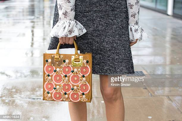 Fashion stylist and presenter Martha Ward wears a Dolce and Gabbana skirt and top Sophie Hulme bag on day 5 during London Fashion Week Spring/Summer...